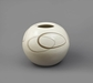 5136 A white ground ceramic vase with a design of circles. Signed: Mitsu