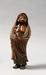 5945 A boxwood okimono (decorative object) of Daruma. The figure stands wra