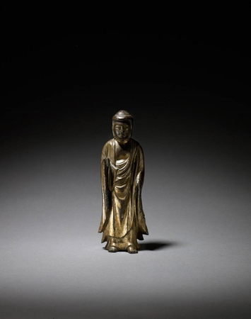 6691 A gilt bronze standing figure of Amida Nyorai. Japan 13th/14th cent