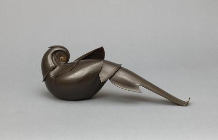 6862 A hammered bronze okimono (decorative object) of a stylized bird Jap