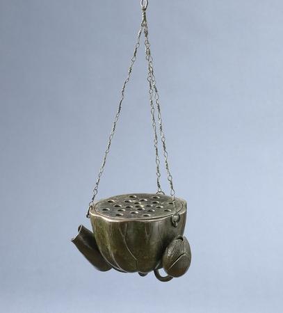 6926 A bronze hanging flower vessel of lotus form. Japan 19th century Edo