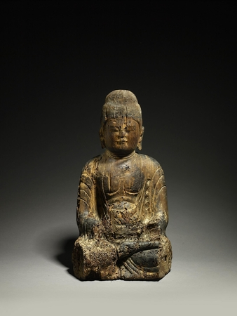 6941 A carved wood figure of a seated Buddha. Japan 12th century Heian pe