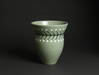 7022 A ceramic flower vessel of light green colour with a black linear desi