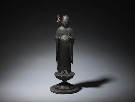 7136 A carved wood figure of Jizō Bosatsu standing on a lotus base.